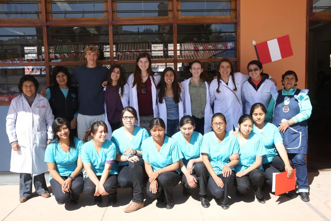 Projects Abroad volunteers take a group photo with local medical professionals in Peru.